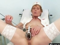 Old mommy self exam on gynochair with speculum
