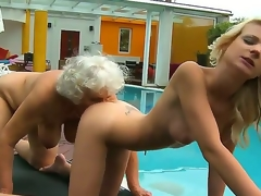 Horny lesbian grannies Candy Paramour and Norma enjoy getting intimate underneath the warm sunshine