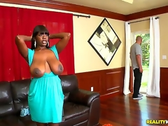 Chimille Morgan was in the centre of ironing her clothes when Jmac dropped by. Busty dark doxy drops what shes doing to let him fuck her senseless and cum all over her huge tits!