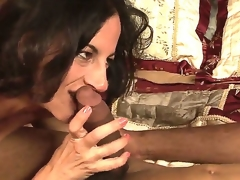Lusty turned on dark brown milf Melissa Monet with natural hanging tits gives head to dirty black dude and rides on his cock in bedroom while her hubby is at work.