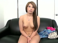 Youthful amateur dark brown Nadia Cox with large round bouncing wazoo and miniature boobies receives naked at the interview and polishes her bald fish lips on couch in close up.