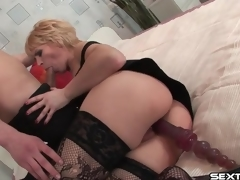 Older slut with toy in her cunt sucks cock