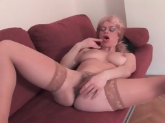 Mature blond disrobes exposed and toys her pussy