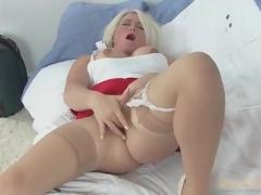 Solo blond mama in skirt and stockings masturbates
