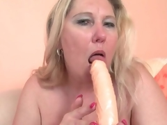 Chubby golden-haired older fucks her cunt with a toy