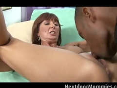 Aged woman takes a chunky darksome cock