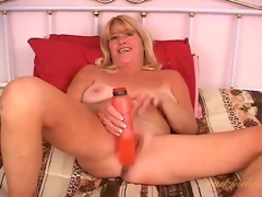 Flirty solo mature fucks her cum-hole with a toy